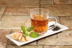 Cup with green tea and leaves Royalty Free Stock Images