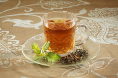 Cup with green tea and leaves Stock Images