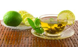 Cup of green tea with lemon, lime and mint. Stock Image