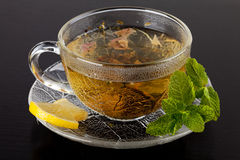 Cup of green tea with lemon and mint Stock Photos
