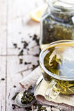 Cup of green tea and lemon Royalty Free Stock Photography