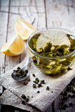 Cup of green tea and lemon. On rustic wooden table Royalty Free Stock Photography