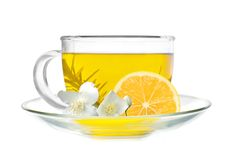 Cup of green tea with lemon slice and jasmine flowers Royalty Free Stock Image