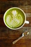 A cup of green tea matcha latte.  stock photos