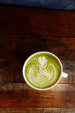 A cup of green tea matcha latte Royalty Free Stock Images