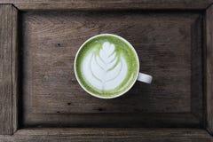 A cup of green tea matcha latte Stock Photos