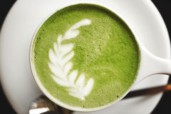 Cup of green tea matcha latte Stock Photos