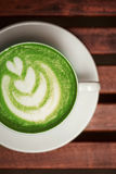 Cup of green tea matcha with latte art Royalty Free Stock Photos