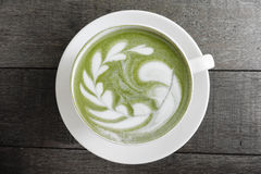 A cup of green tea matcha latte Stock Photos