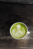 A cup of green tea matcha latte Stock Image