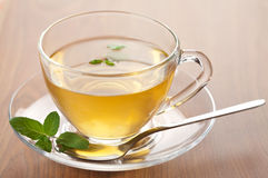Cup of green tea with mint Stock Photo