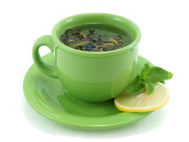 Cup with green tea, with mint and lemon stock photo