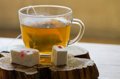 Cup of green tea and  pastille, with fruit jelly on a wooden stand Stock Photography