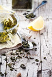 Cup of green tea, spoon and lemon Stock Image