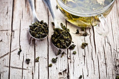 Cup of green tea and spoons Stock Image