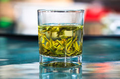 Cup of green tea on the table Stock Photography