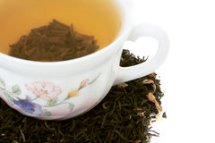 Cup of green tea and tea leaves with dry jasmin Stock Photos