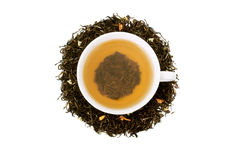 Cup of green tea and tea leaves with dry jasmin Royalty Free Stock Photos