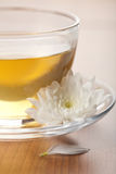 Cup of green tea and white flower Royalty Free Stock Photography