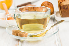 Cup of green tea on wood Stock Images