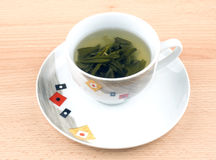 Cup of green tea on wooden table Royalty Free Stock Photos