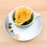 Cup of green tea with yellow rose Royalty Free Stock Photography