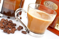 Cup, grinder, coffee pot and beans Stock Photography