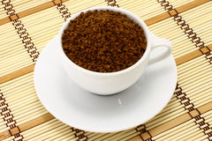 Cup of ground coffee Stock Image
