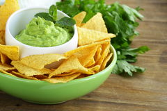 Cup with guacamole and corn chips Royalty Free Stock Photography
