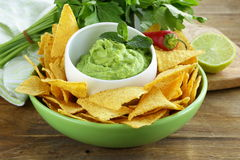 Cup with guacamole and corn chips Stock Image