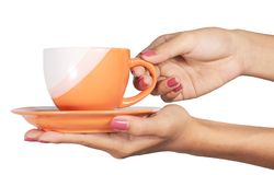 A cup in a hand Stock Photography