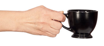 Cup in hand Royalty Free Stock Photography