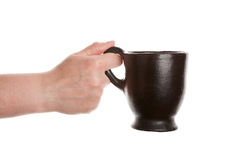 Cup in hand Royalty Free Stock Images