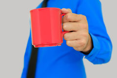 Cup in hand. Stock Photos