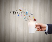 Cup in hand Royalty Free Stock Photos