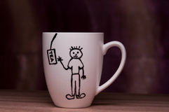 Cup with Hand-drawn man and tea bag Stock Image