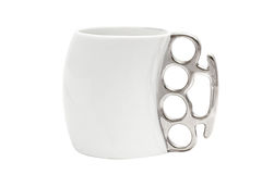 A cup with a handle in the form of brass knuckles Stock Photography