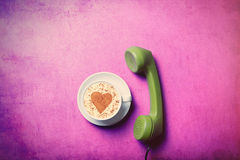 Cup and handset Stock Photo