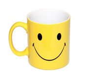 A cup with a happy face isolated  on white background. A cup with a picture of a yellow happy face isolated on white background Royalty Free Stock Photos