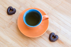 Cup of healthy green tea and chocolates Stock Photography