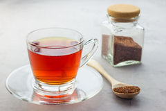 Cup of healthy herbal rooibos red tea in glass cup. And dry tea on background Stock Image