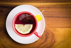 Cup of healthy herbal tea with lemon Royalty Free Stock Images