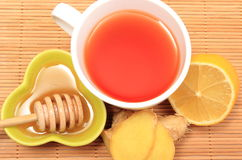 Cup of healthy tea with honey ginger and lemon Stock Images