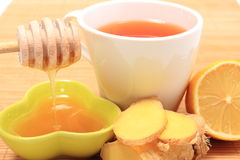 Cup of healthy tea with honey ginger and lemon Stock Photos