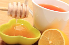 Cup of healthy tea with honey and lemon Stock Image
