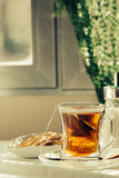 Cup of Healthy Tea over breakfast table Royalty Free Stock Images