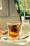 Cup of Healthy Tea over breakfast table Stock Image