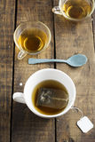 Cup of Healthy Tea over wood background Stock Photo