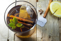 Cup of Healthy Tea over wood background Royalty Free Stock Images