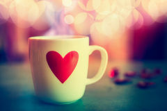 Cup with heart at bokeh background, front view. Love symbol or Valentines day Stock Image